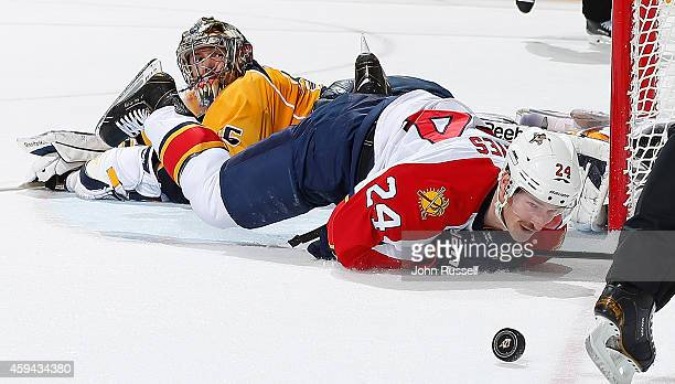 Pekka Rinne of the Nashville Predators secures the shootout win against Brad Boyes of the Florida Panthers at Bridgestone Arena on November 22 2014...