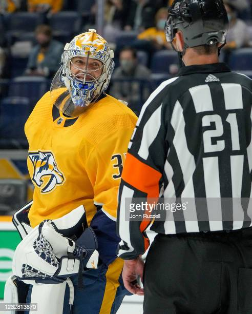 Pekka Rinne of the Nashville Predators smiles at referee TJ Luxmore during a stoppage in play against the Carolina Hurricanes during the first period...