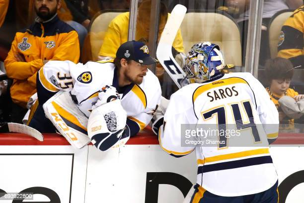 Pekka Rinne of the Nashville Predators speaks to Juuse Saros from the bench in the second period against the Pittsburgh Penguins in Game Five of the...