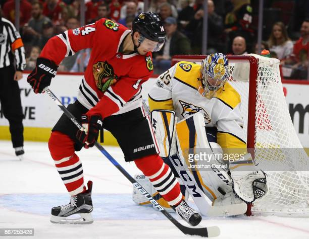 Pekka Rinne of the Nashville Predators stops a shot by Artem Anisimov of the Chicago Blackhawks at the United Center on October 27 2017 in Chicago...
