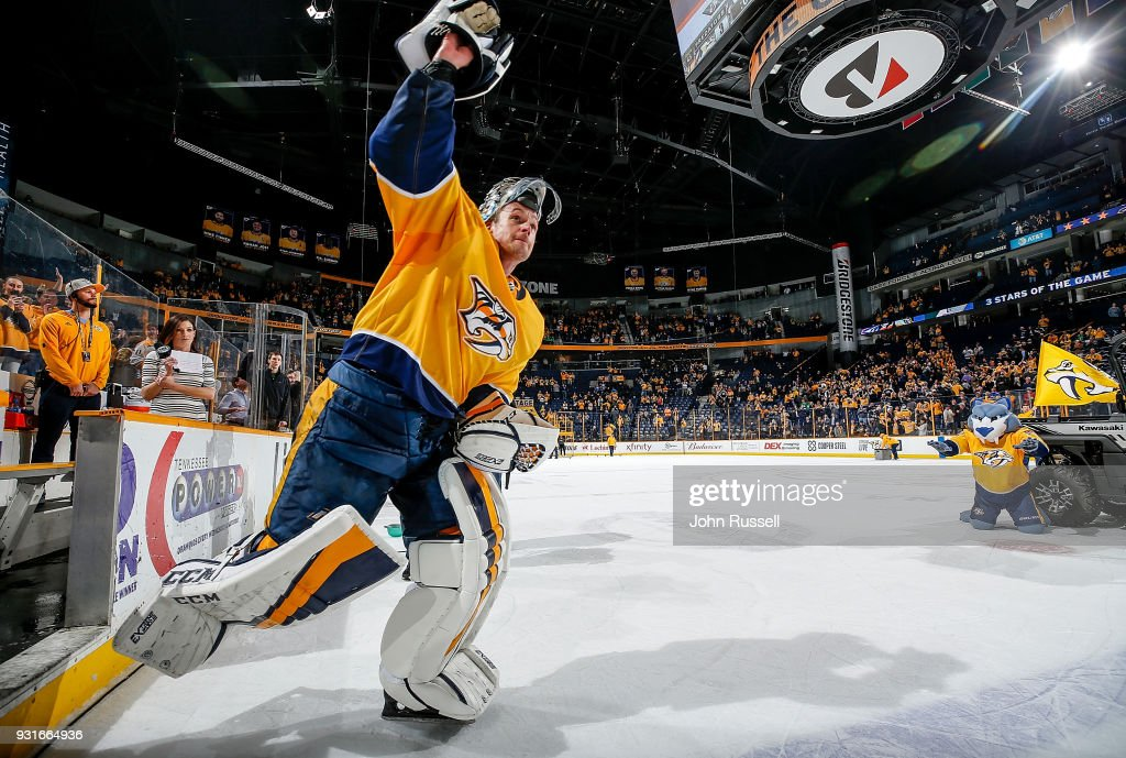 Pekka Rinne #35 of the Nashville Predators waves to the crowd after a 3-1 win against the Winnipeg Jets during an NHL game at Bridgestone Arena on March 13, 2018 in Nashville, Tennessee.