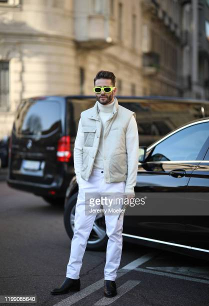 Pelayo Diaz is seen wearing a Versace sunglasses and Ferragamo vest during Milan Fashion Week Fall/Winter 2020/2021 poses on January 12 2020 in Milan...