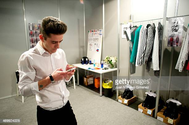 Pelayo Diaz Zapico prepare backstage before a fashion show during the Mercedes Benz Fashion Week Winter/Fall Madrid 2014 at Ifema on February 17 2014...