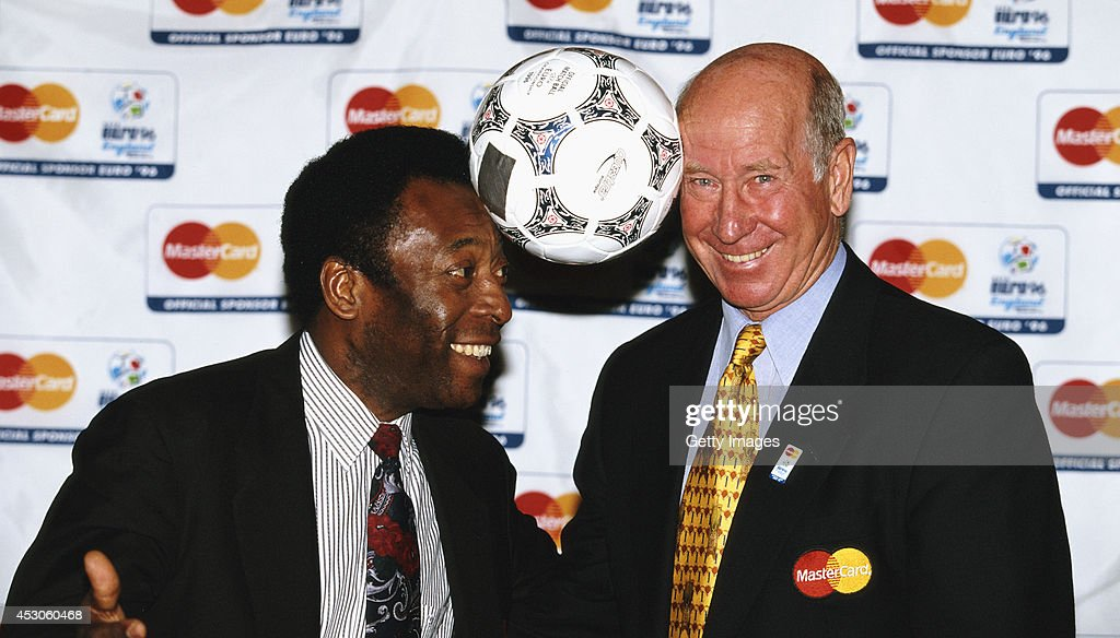 Pele (l)and Bobby Charlton pose with a match ball for a picture during EURO '96.