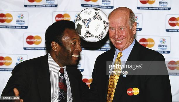 Pele and Bobby Charlton pose with a match ball for a picture during EURO '96