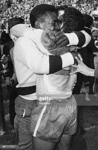 Pele embracing a team mate after Brazil beat Czechoslovakia 3- 1 in the final of the 1962 World Cup, Estadio Nacional, Santiago, Chile, 17th July...