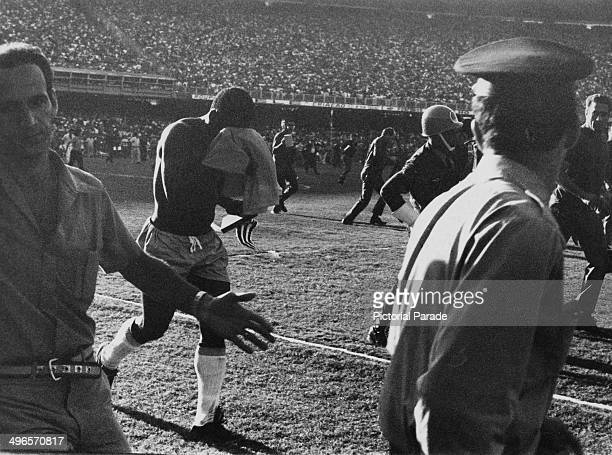 Pele hides his face as after his last game for Brazil, it was against Yugoslavia at the Maracana Stadium in Rio de Janeiro, 18th July 1971.