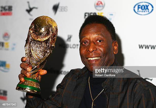 Pele holds a replica Wolrd Cup trophy during a press conference at The Peninsula on March 26 2015 in Melbourne Australia