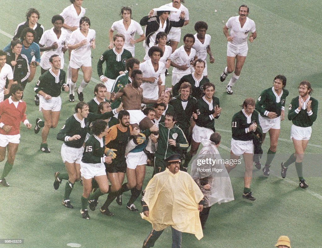 Pele leaves the field following his final game. Pele played for his two club teams, New York Cosmos in the first half and Santos FC in the second half during the game played on October 1, 1977 in East Rutherford, New Jersey.