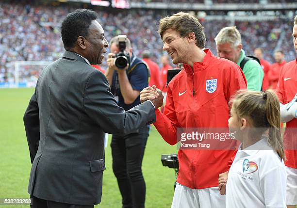 Pele meets Louis Tomlinson during Soccer Aid 2016 at Old Trafford on June 5 2016 in Manchester United Kingdom