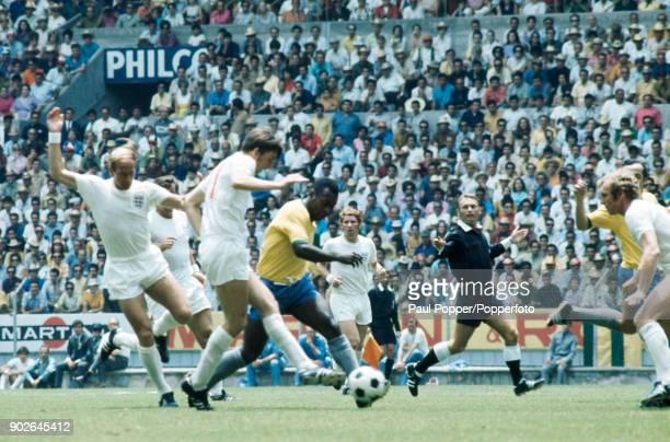 Pele of Brazil causes problems for the England defence with Martin Peters attemtping to tackle watched by Bobby Charlton Alan Ball referee Abraham...