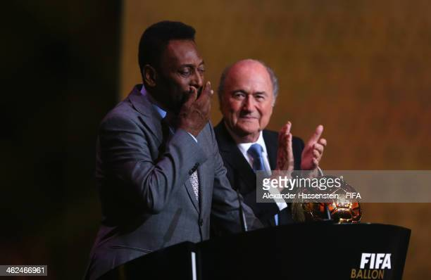 Pele of Brazil wipes tears from his eyes after receiving the FIFA Ballon d'Or Prix d'Honneur award from FIFA President Joseph S Blatter during the...