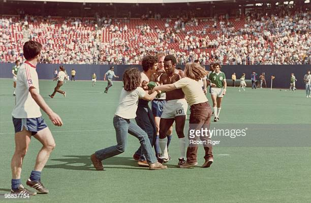 Pele of New York Cosmos is accosted by fans following a game at Giants Stadium in East Rutherford, New Jersey, circa 1975-77.