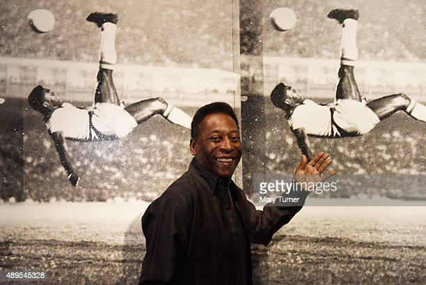 Pele poses in front of Russell Young Bicycle Kick as he launches Art Life Football at Halcyon Gallery on September 22 2015 in London England