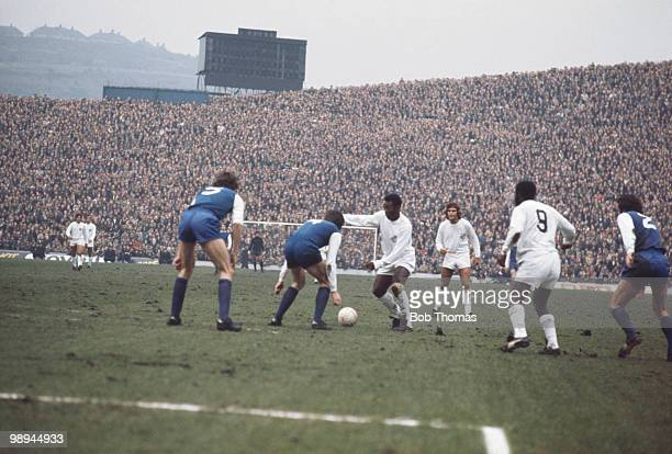 Pele takes on the Sheffield Wednesday defence during a game between Santos and Wednesday at Hillsborough, 23rd February 1972.