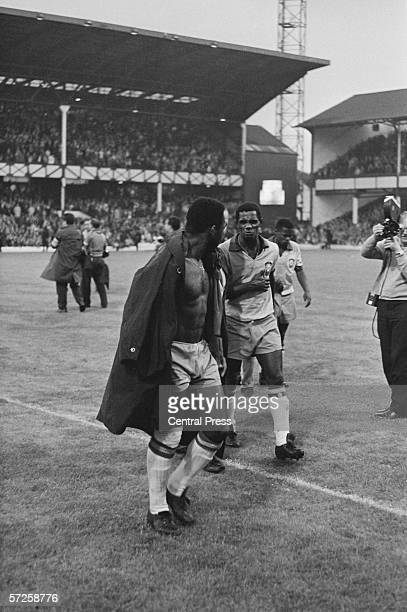 Pele talking to a Portuguese player after the Group C match between Brazil and Portugal at Goodison Park during the 1966 World Cup in England 19th...
