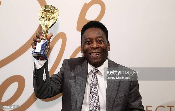 Pele with a replica Jules Rimet trophy attends a photocall for the Pele: THE COLLECTION at Julien Auctions on June 1, 2016 in London, England