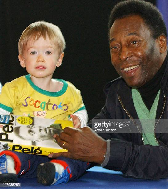 Pele with young fan during Pele signs copies of his Autobiography PELE May 22 2006 at Books ETC in London Great Britain