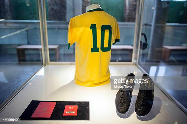 Pele's passport #10 jersey and football boots on display at Pele Museum on June 20 2014 in Santos Brazil The 4000 square meter complex is located in...