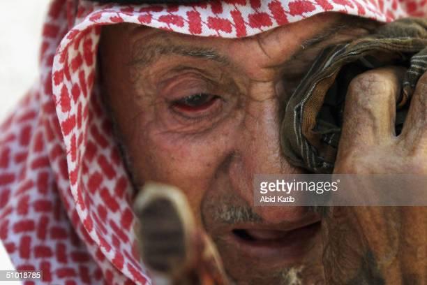 Pelestinian man, Mouhamad Al-Arja, mourns his 25 year-old grandson Yassir al-Arja, a scrap dealer from Rafah's Brazil neighborhood, who was shot dead...