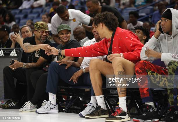 Pelicans player Jaxson Hayes shakes hands with Juvenile during the BIG3 Playoffs at Smoothie King Center on August 25, 2019 in New Orleans, Louisiana.
