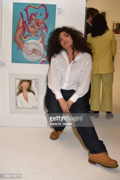 Pelin Pelin attends a private view of '100 Women' an exhibition of fashion illustration to celebrate the centenary of women's suffrage at SHOWstudio...