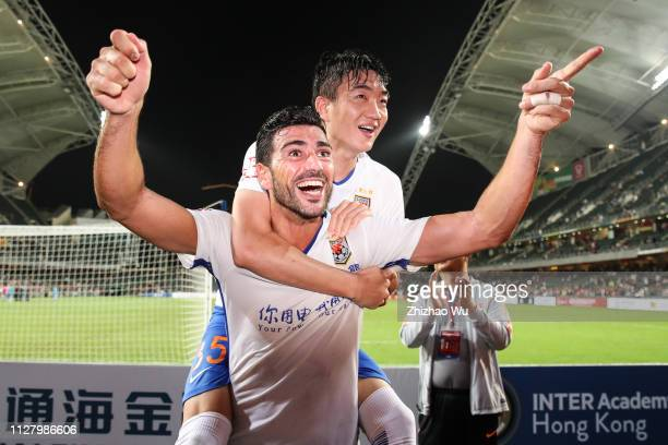 Pelle Graziano and Dai Lin of Shandong Luneng Taishan FC celebrate the victory with fans after Tonghai Financial Chinese New Year Cup 2019 between...