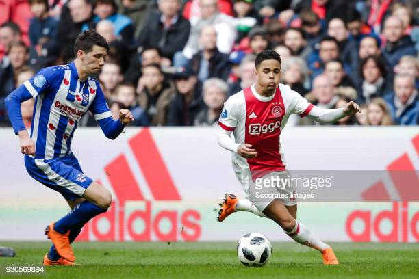 Pelle van Amersfoort of SC Heerenveen Justin Kluivert of Ajax during the Dutch Eredivisie match between Ajax v SC Heerenveen at the Johan Cruijff...