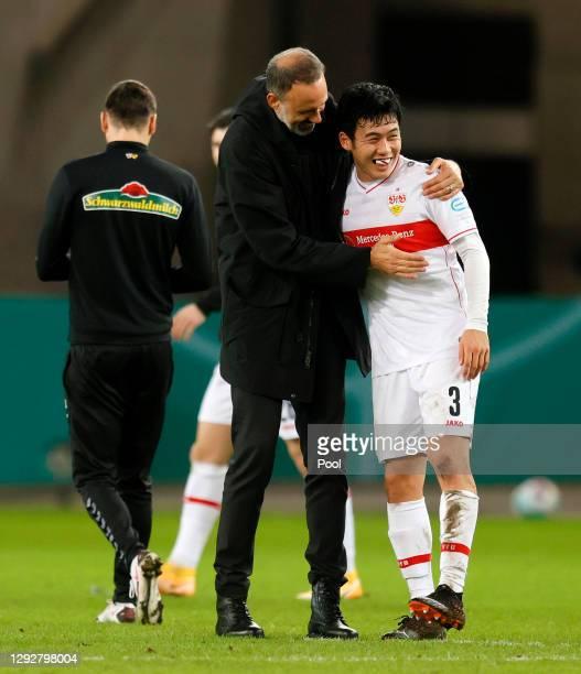 Pellegrino Matarazzo, Head Coach of VfB Stuttgart celebrates victory with Wataru Endo of VfB Stuttgart during the DFB Cup second round match between...