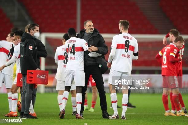 Pellegrino Matarazzo, Head Coach of VfB Stuttgart celebrates with Sasa Kalajdzic and Silas Wamangituka of VfB Stuttgart embraces after the Bundesliga...