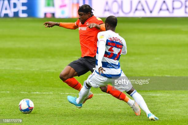 Pelly Ruddock of Luton town battles for possession with Albert Adomah of QPR during the Sky Bet Championship match between Queens Park Rangers and...