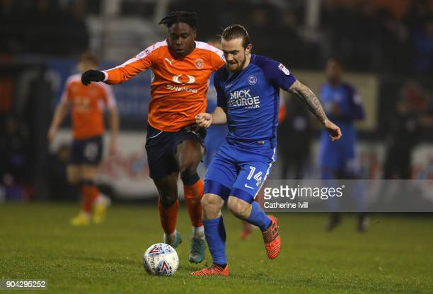 Pelly RuddockMpanzu of Luton Town and Jack Marriott of Peterborough United during the EFL Checkatrade Trophy Third Round match between Luton Town and...