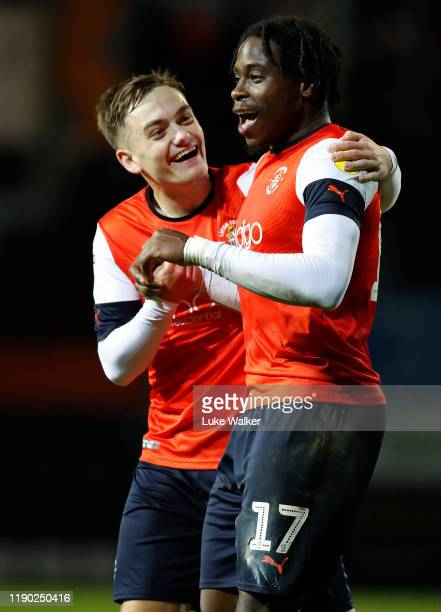 Pelly-Ruddock Mpanzu and Luke Bolton of Luton Town celebrate the win during the Sky Bet Championship match between Luton Town and Charlton Athletic...