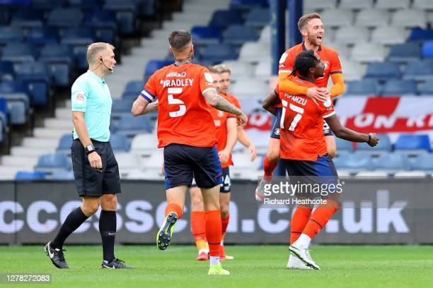Pelly-Ruddock Mpanzu of Luton Town celebrates with teammates after scoring his team's first goal during the Sky Bet Championship match between Luton...