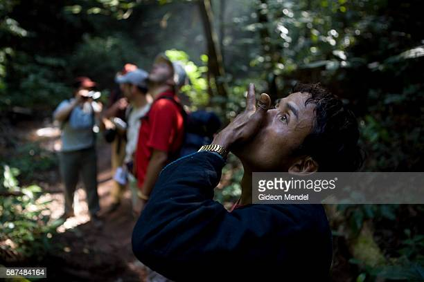 Pelo is from the Akha village of Ban Nam Lai Here he demonstrates his bird calling skills to a group of trekkers The Akha traditionally hunt birds...
