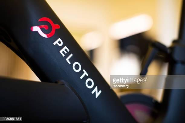 Peloton Interactive Inc. Logo on a stationary bike at the company's showroom in Dedham, Massachusetts, U.S., on Wednesday, Feb. 3, 2021. Peloton...