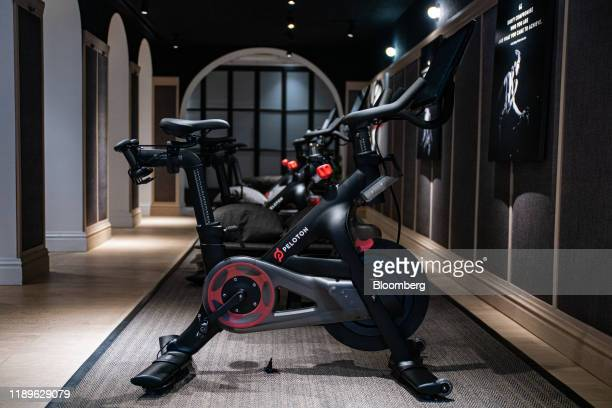 Peloton Interactive Inc. Stationary bicycles sit on display at the company's showroom on Madison Avenue in New York, U.S., on Wednesday, Dec. 18,...