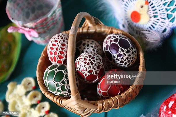 Pelplin Poland 20th March 2016 People attend the Easter market during the Palm Sunday in the Cistercian monastery in Peplin Visitors can buy...
