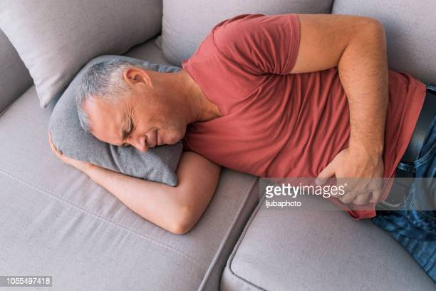 pelvic pain - human intestine stock photos and pictures