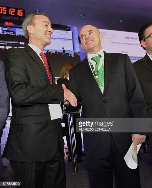 Pemex oil company president Jose Antonio Gonzalez congratulates Timothy Joseph Callahan a representative of BHP Billiton Petroleo Operaciones de...