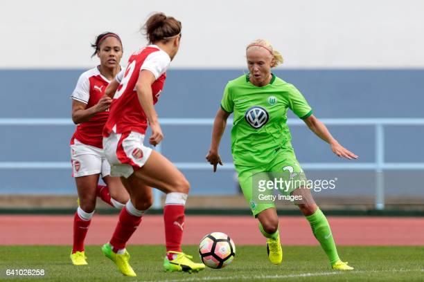 Pemille Harder of Wolfsburg challenges Alex Scott of Arsenal during the Women's Friendly Match between VfL Wolfsburg Women's and Arsenal FC Women on...