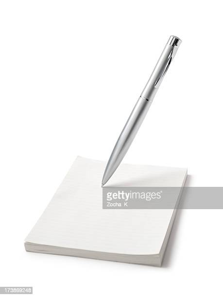 Pen and notepad isolated on white