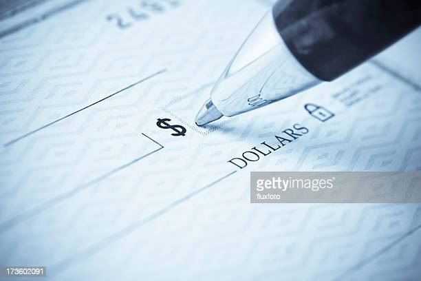 pen being used to write a check - writing stock pictures, royalty-free photos & images