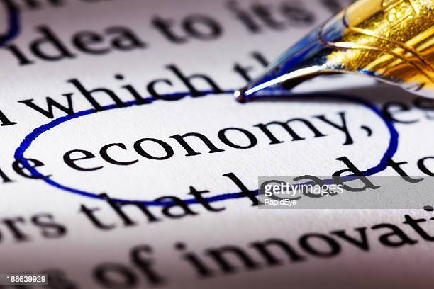"""Pen circles word"""" economy"""" in printed document"""