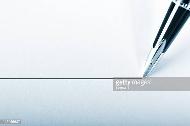 a pen drawing a precision point line on white paper - narrow stock pictures, royalty-free photos & images