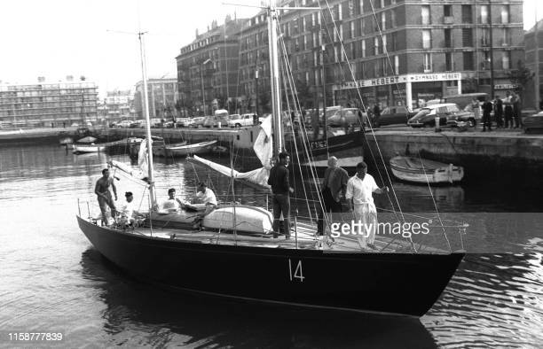 """""""Pen Duick II"""" leaves the dock where he was anchored in Le Havre, to start the race cruise Yarmouth - Santander . On the deck of the boat, we..."""