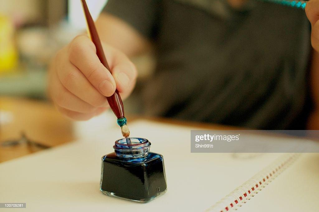 Pen in ink bottle : Stock Photo