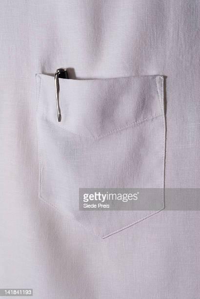 Pen in white shirt pocket