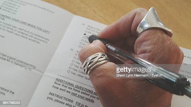 pen marking check box - survey stock photos and pictures