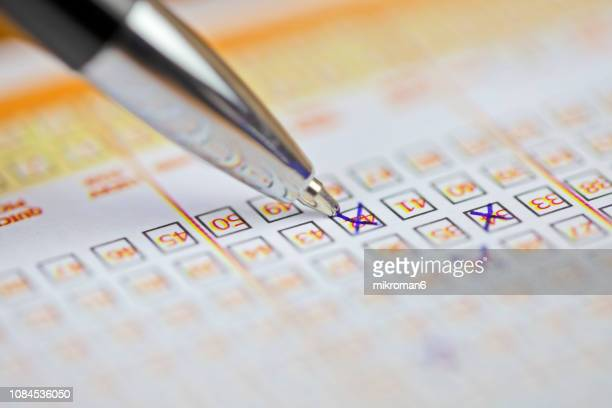 pen markings on lottery ticket. filled in lottery ticket - gambling stock pictures, royalty-free photos & images